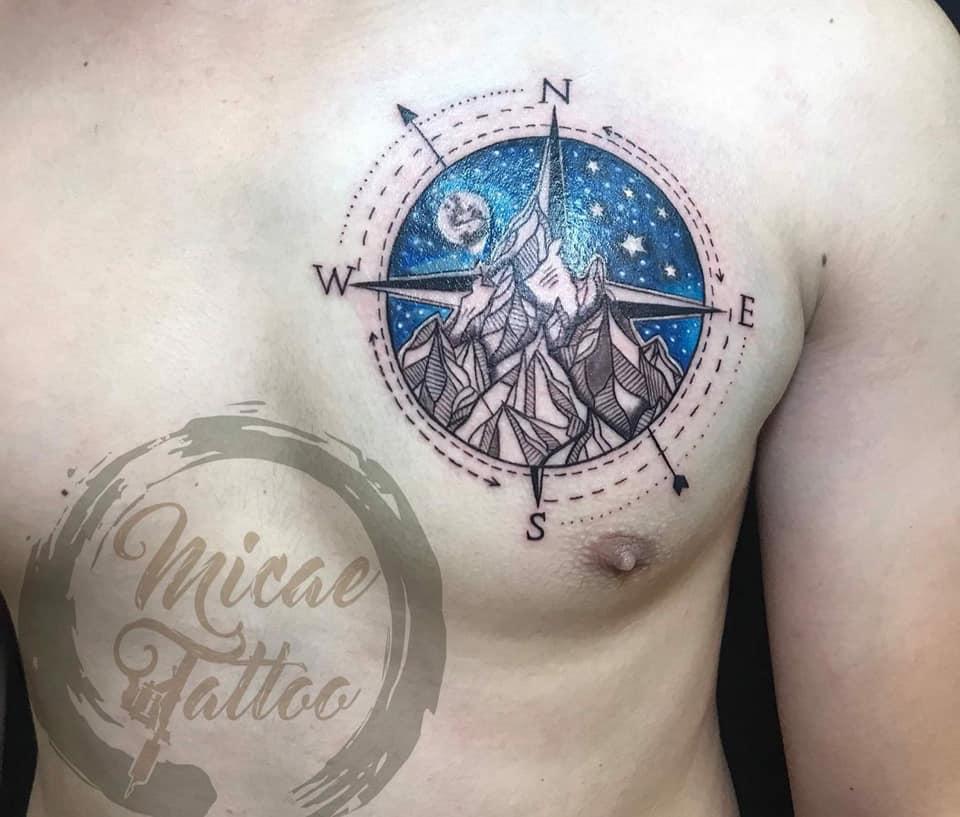 Hình xăm Hình xăm la bàn trên bắp tay Micae tattoo tại tiệm xăm